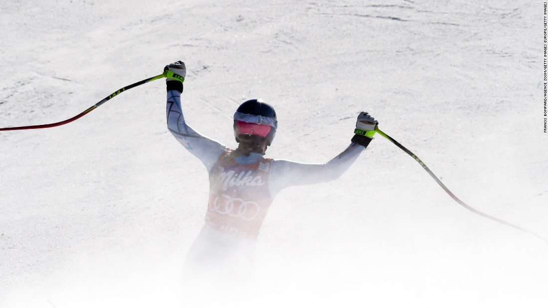 Vonn raises her arms after crossing the finish line at Cortina d'Ampezzo.