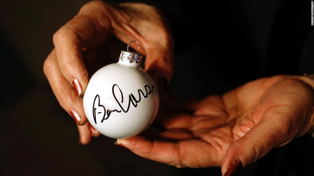 Darlene Loudon holds an ornament that Republican presidential candidate Ben Carson autographed for her after a town hall at Adams Street Espresso & Soda Shoppe in Creston, Iowa, on Friday, January 22. Caucuses are scheduled for February 1.