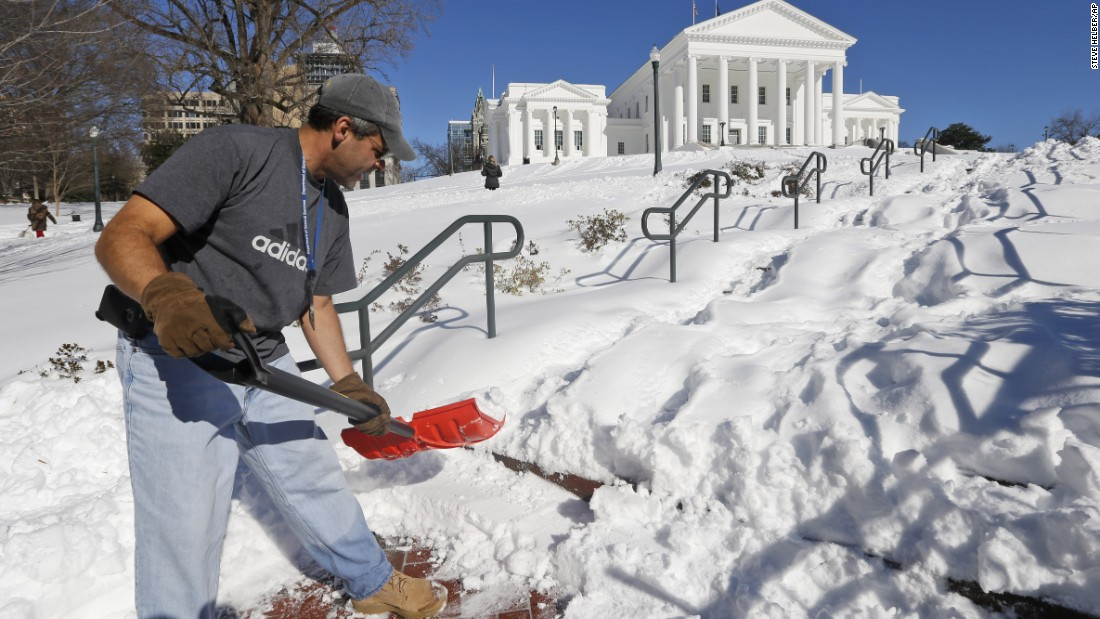 Joe Damico, deputy director of the Virginia Department of General Services, shovels a walkway to the State Capitol in Richmond, Virginia, on January 24.