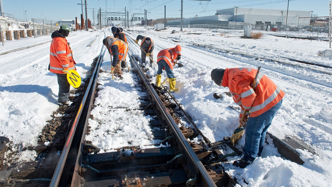 Workers clear snow from Long Island Railroad tracks on January 24.