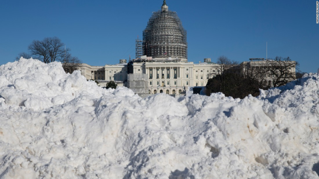 Snow is piled in front of the U.S. Capitol on January 24.