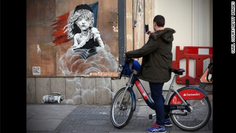 Banksy's first interactive artwork takes aim at French police