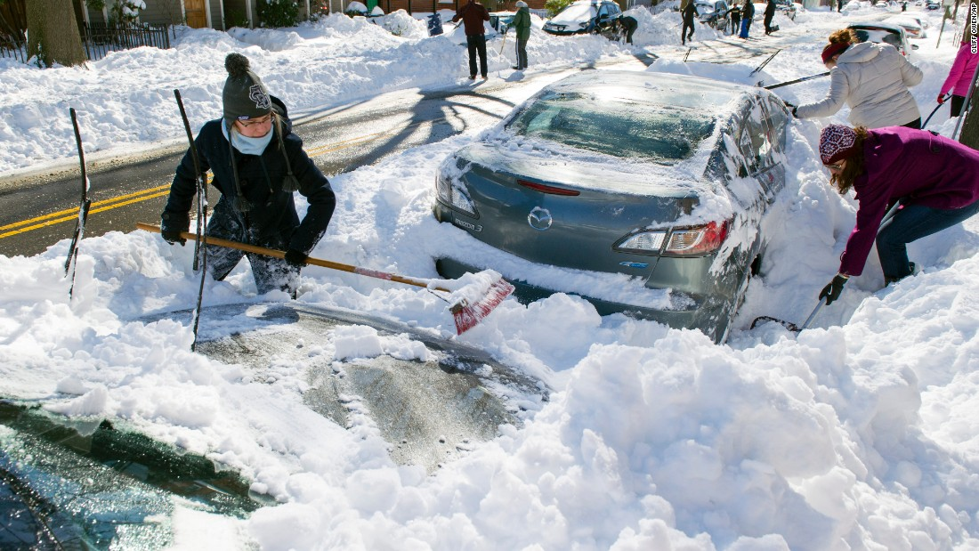 People dig out their cars in Alexandria, Virginia, on January 24.