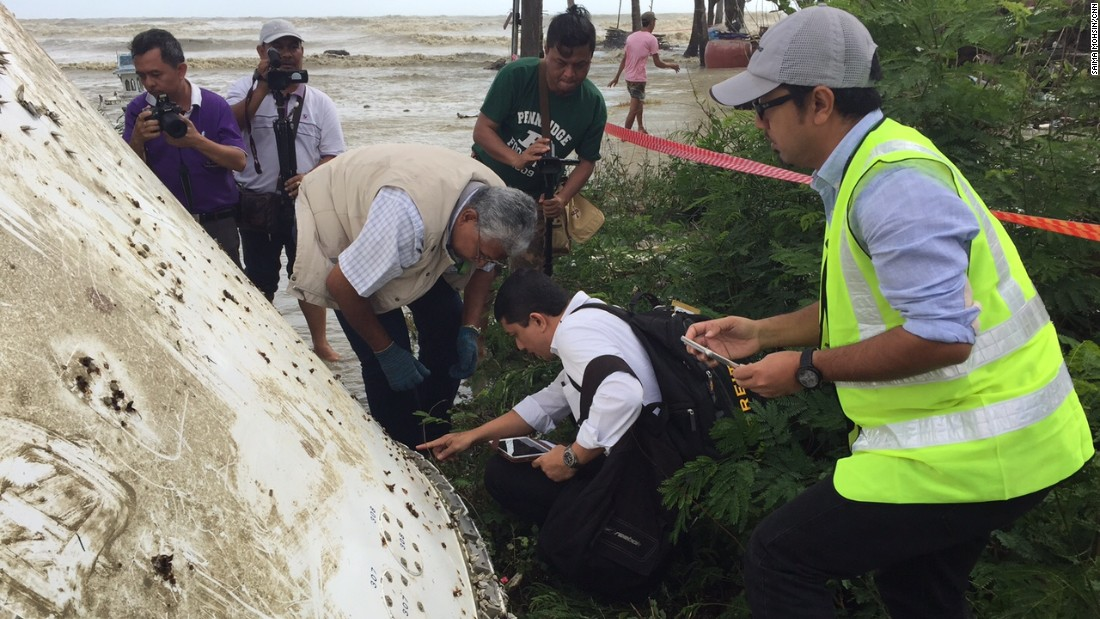 Experts inspect the rivets on the debris. They tell CNN although bolts and rivets are used on a 777 aircraft's frame, they would not appear on the external fuselage of a plane. This brings into question whether the debris could be a part of MH370.