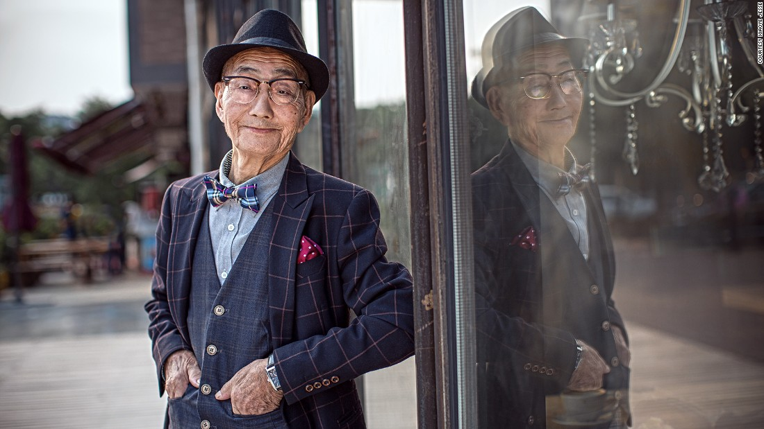 A photo series of Ding, nattily dressed and striking elegant poses, taken by his fashion photographer grandson recently went viral Chinese social media.