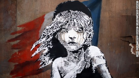 London artist Banksy takes aim at French police aggression.