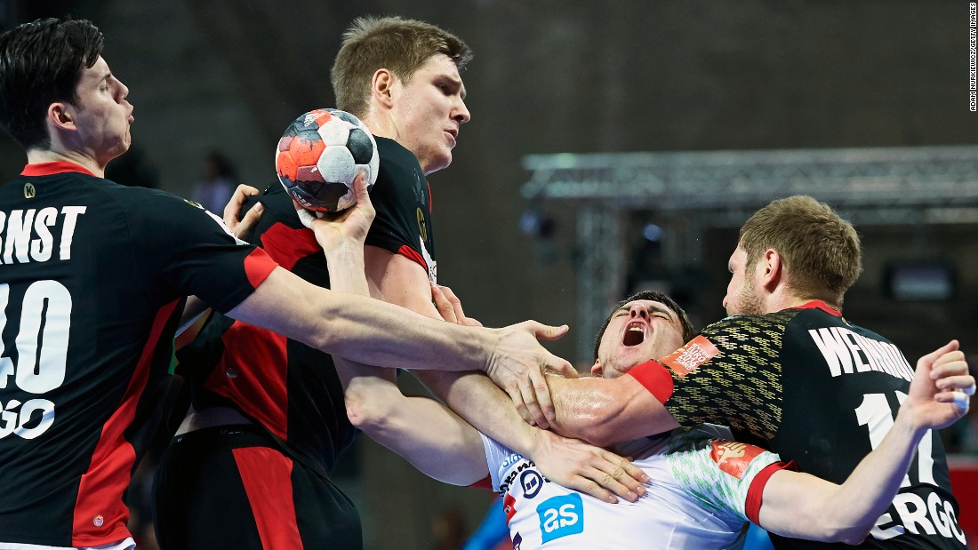 Slovenian handball player Sebastian Skube is met by three German players during a European Championship match on Wednesday, January 20.