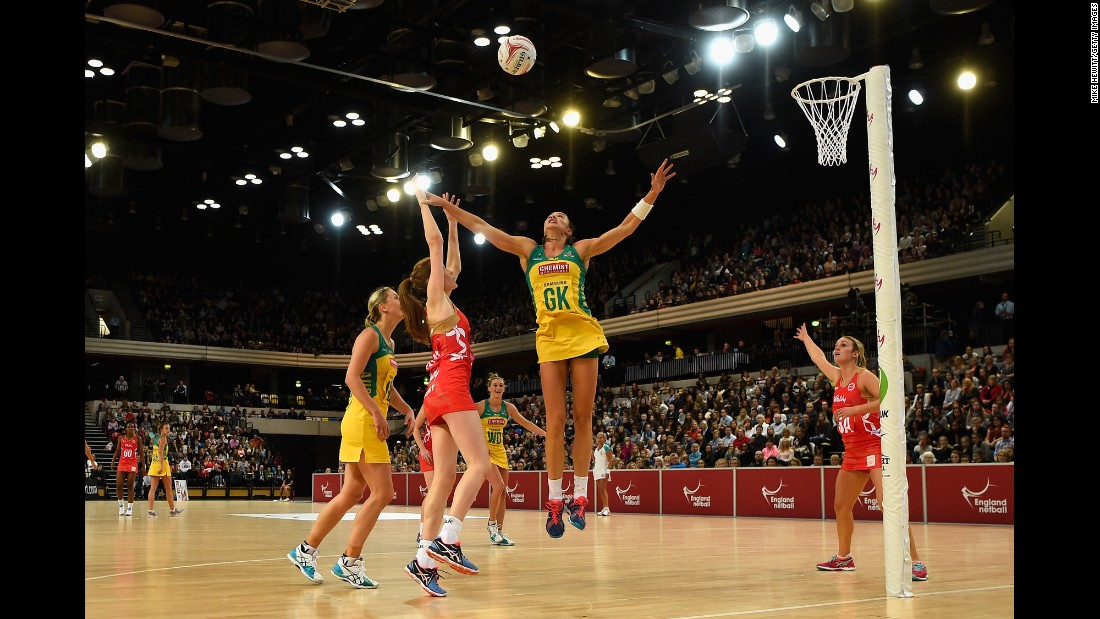 England's Helen Housby shoots over Australia's Sharni Layton during a netball game in London on Friday, January 22. Australia swept the three-game series.