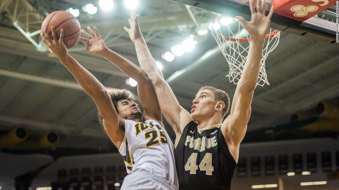 Iowa's Dom Uhl tries to score over Purdue's Isaac Haas during a Big Ten basketball game in Iowa City, Iowa, on Sunday, January 24.