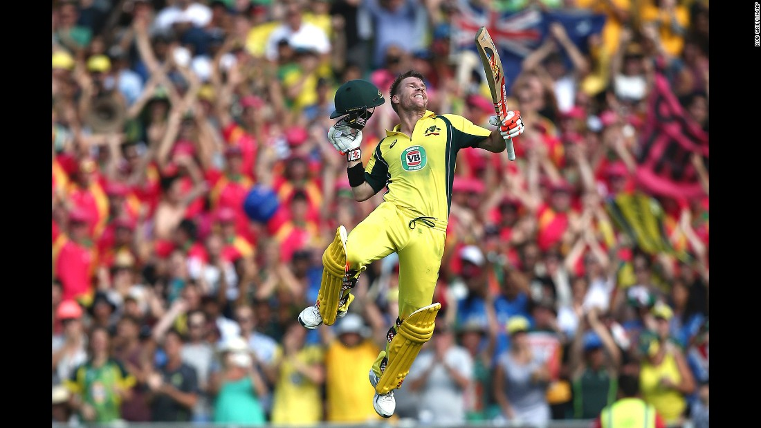 Australian cricketer David Warner jumps into the air after hitting a century against India on Saturday, January 23. But India won the match by six wickets -- its only victory in the five-match series played in Australia.