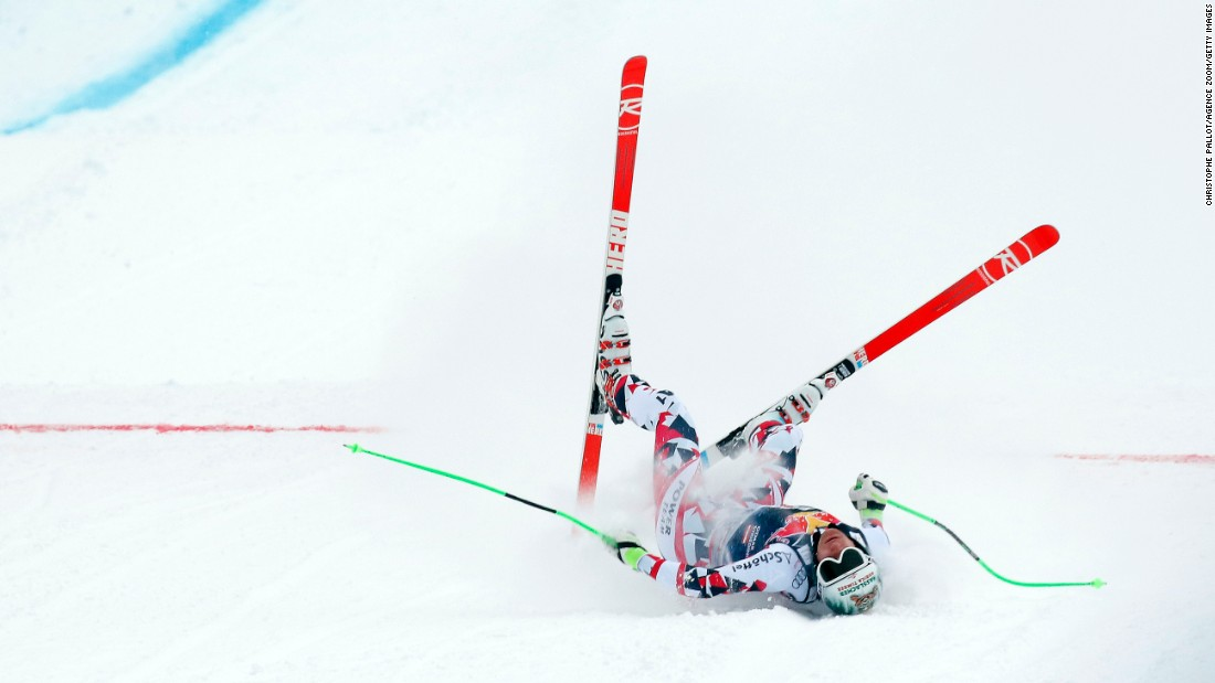 Austrian skier Otmar Striedinger lies on the ground after wiping out at the end of his downhill run in Kitzbuehel, Austria, on Saturday, January 23.