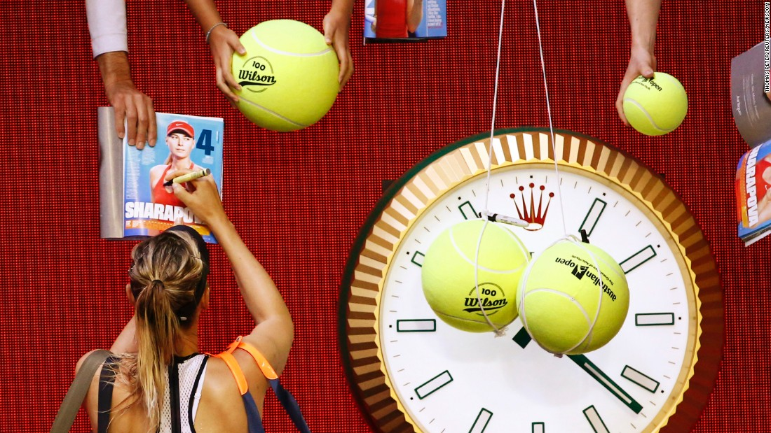 Maria Sharapova signs autographs after winning her fourth-round match at the Australian Open on Sunday, January 24.