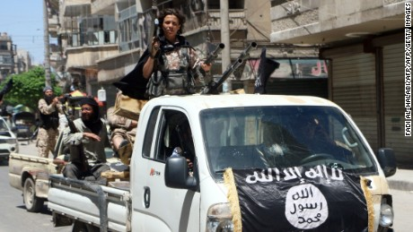 Fighters from Al-Qaeda's Syrian affiliate Al-Nusra Front drive in armed vehicles in the northern Syrian city of Aleppo as they head to a frontline, on May 26, 2015.