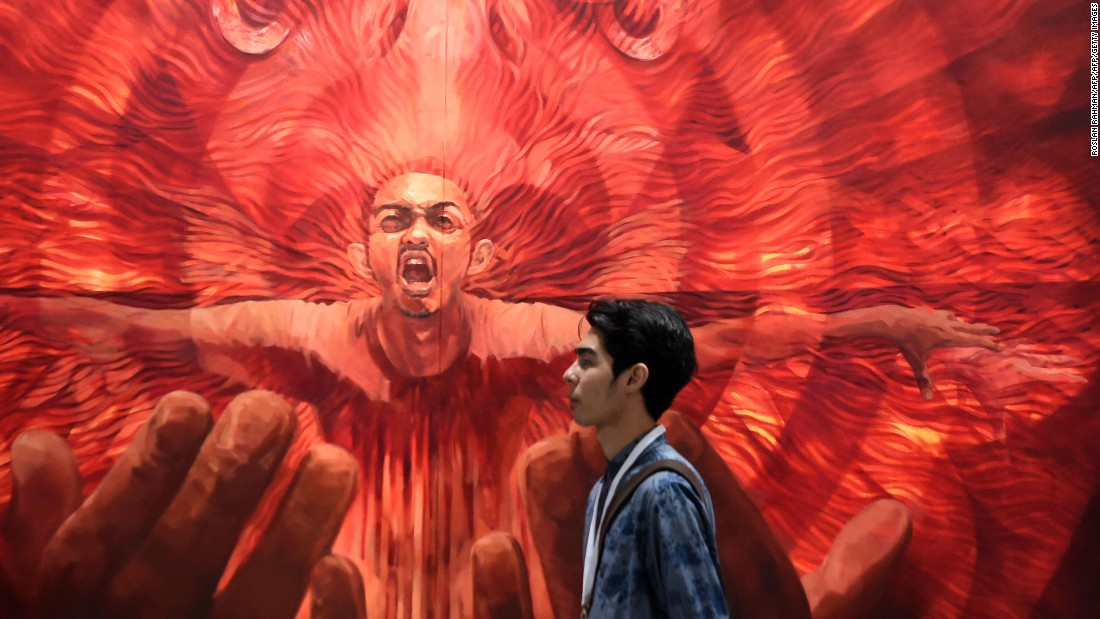 "The Malaysian artist showcased a series of oil on canvas paintings, including the above ""Resurrection."""