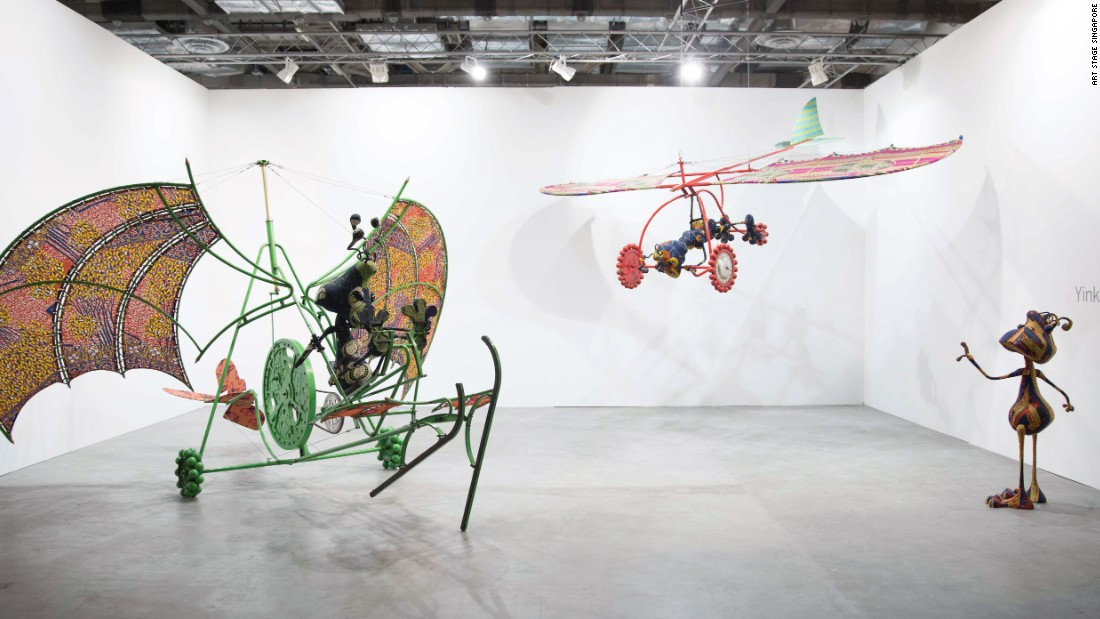 "Shonibare's ""Alien Man on Flying Machine,"" ""Alien Woman on Flying Machine""  and ""Alien Child"" -- pictured above -- are part of his series <em>Invasion, Escape: Aliens Do it right!</em>"