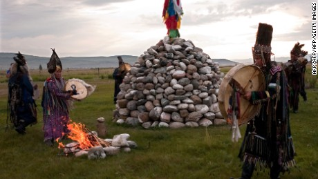 A picture taken on August 20, 2010 shows shamans of Tyva Republic performing a shamanistic ritual ceremony at sacred site outside Kyzyl. AFP PHOTO / VALERY TITIEVSKY (Photo credit should read VALERY TITIEVSKY/AFP/Getty Images)
