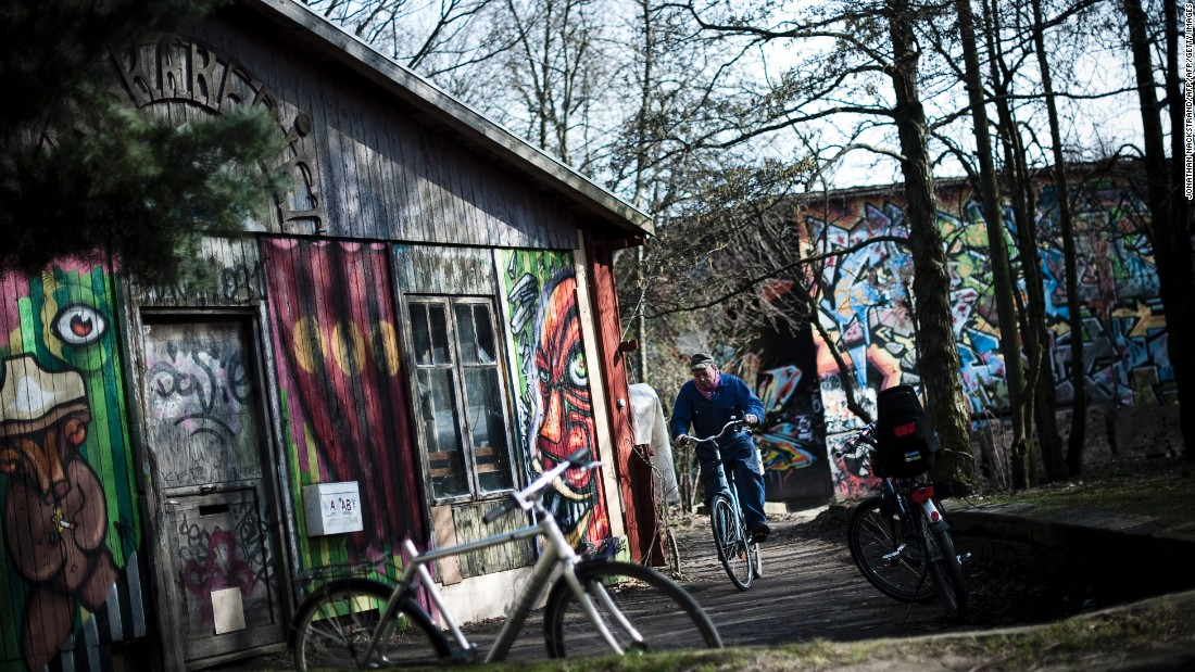 A social experiment that began in 1971, Christiania was founded in central Copenhagen by a group of Danish hippies squatting on a former military barracks. Despite having built schools, houses and a variety of businesses, today Christiania's population of 850 faces a moral dilemma: Pay the Danish government for the land outright by 2018, or face eviction.
