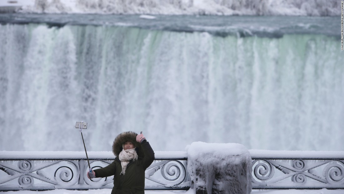 A tourist uses a selfie stick on the Canadian side of Niagara Falls on Saturday, January 23.