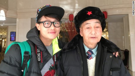 85-year-old Ding Bingcai, right, with grandson Ding Guoliang in a Beijing hotel on January 26, 2016. They are visiting Beijing from southern China's Fujian province to realize Bingcai's dream.