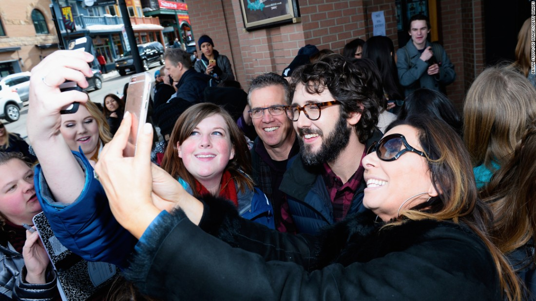 Singer Josh Groban, in the beard and glasses, takes selfies with fans at the Sundance Film Festival in Park City, Utah, on Saturday, January 23.