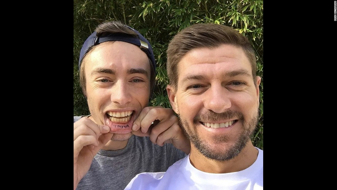 "Former Liverpool captain Steven Gerrard <a href=""https://www.instagram.com/p/BAz4A6EnHsk/"" target=""_blank"">takes a selfie</a> with one of the English soccer club's diehard fans on Thursday, January 21. The fan had ""YNWA"" tattooed on his lip -- a nod to the song ""You'll Never Walk Alone,"" which the club's fans sing before each home match."