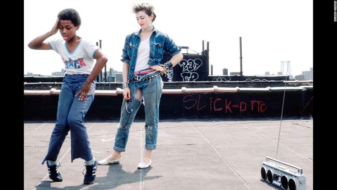"""On the rooftop of Madonna's apartment. """"One of my favorite pictures,"""" photographer Richard Corman said. """"She was as inspired by the kids as they were by her."""""""