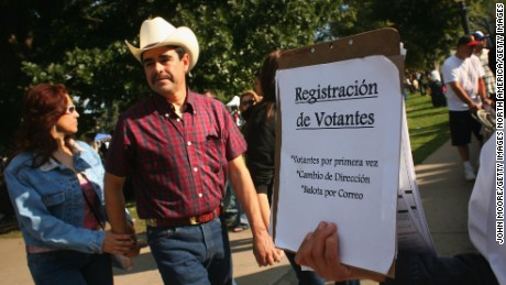 DENVER - SEPTEMBER 14:  Democratic Party workers try to register new voters at a celebration marking Mexican Independence Day September 14, 2008 in Denver, Colorado. The Democratic Party is working hard to register Latino voters in Colorado, an important swing state in November's presidential election.  (Photo by John Moore/Getty Images)