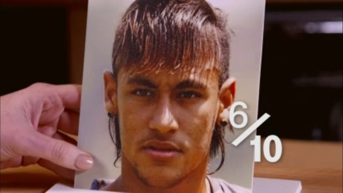 "Neymar, circa 2013: a melange of at least four different hairstyles. ""You've got to bear in mind the time,"" Hart says. ""This was probably when this was vaguely acceptable -- not recently!"" Lengthy fringe, gelled Mohican, shaved sides ... unforgivable mullet. But he is kind to the Barca man: ""That's a 6/10.""<br />"