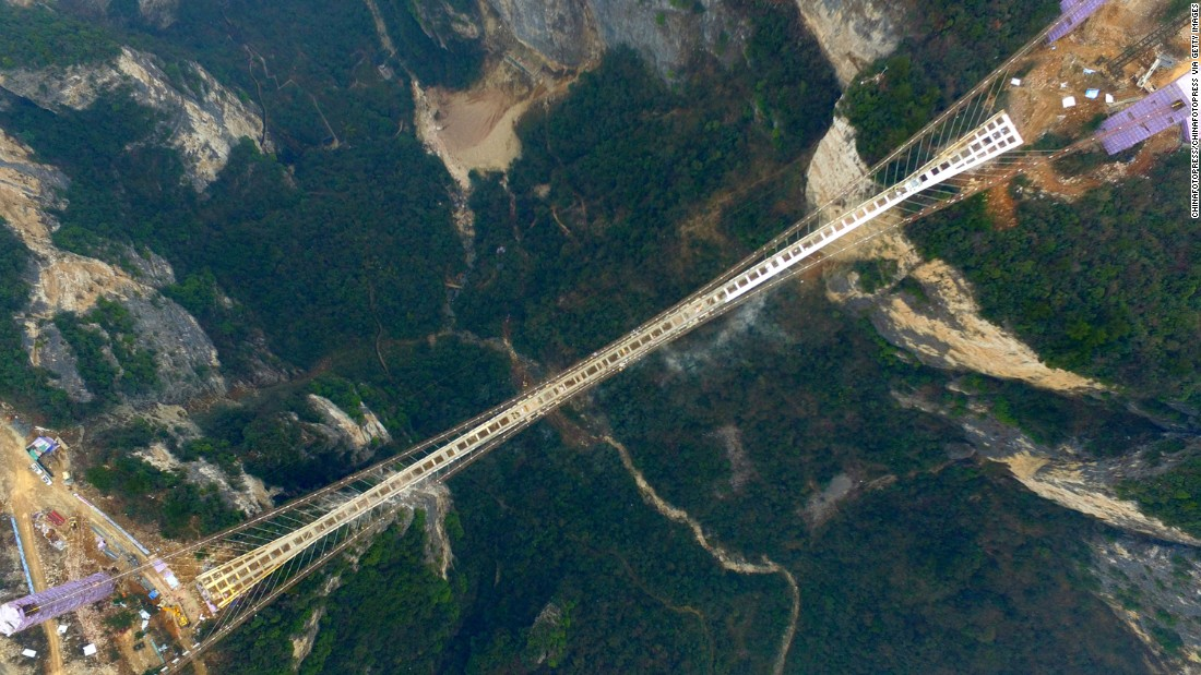 The bridge stretches over two dramatic cliffs in Hunan's Zhangjiajie National Forest Park.
