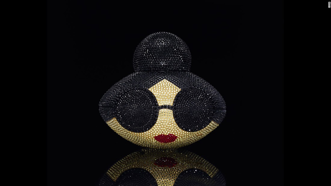 "This ball features the brand's signature ""Stace Face"" icon and is covered in Swarovski crystals."