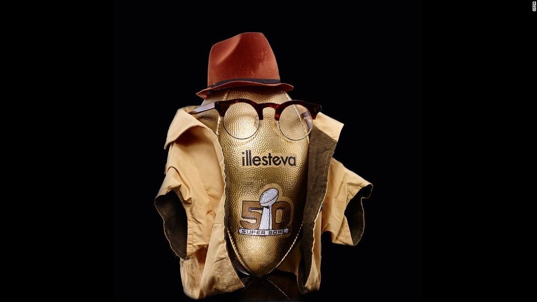 The eyewear label dressed their football in a pair of the brand's glasses, a fedora hat and a mini-trench coat.