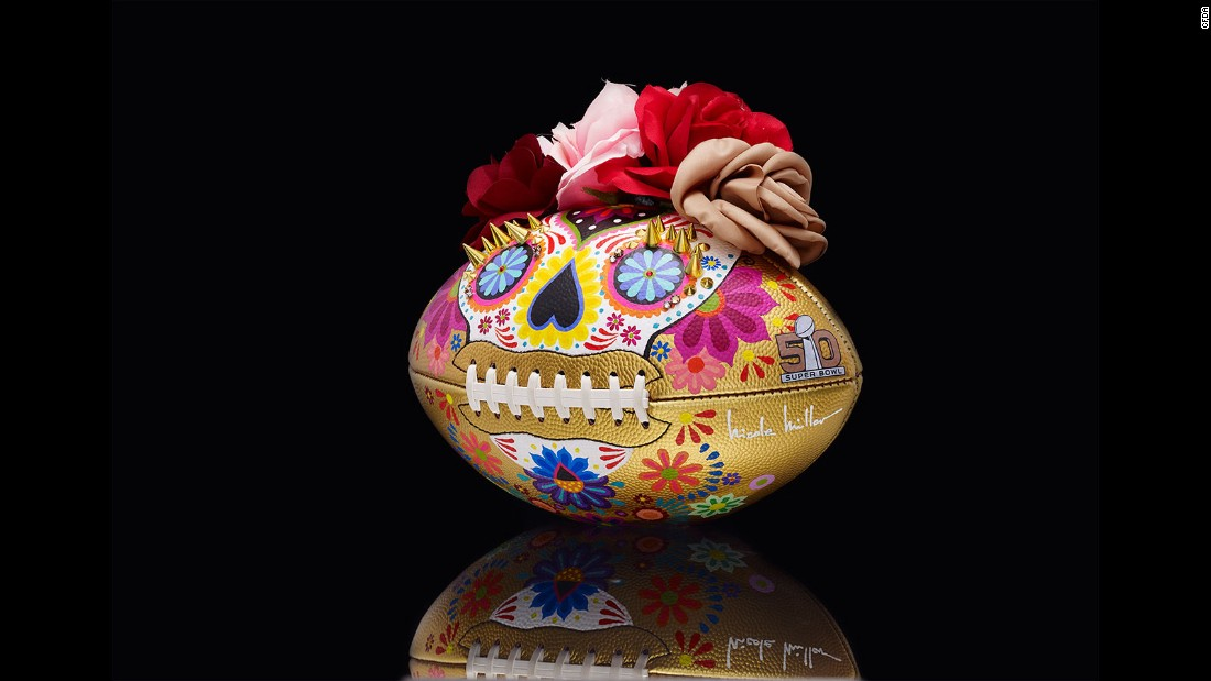 "This ball, perhaps inspired by the Mexican holiday <a href=""http://edition.cnn.com/2015/10/29/living/dia-de-los-muertos-makeup-tradition-feat-irpt/"" target=""_blank"">Day of the Dead</a>, is made of acrylic paint and hand-embellished with metal studs and silk flowers."