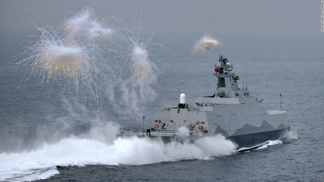 A guided missile corvette launches flares during a drill at sea off Kaohsiung port in southern Taiwan on January 27, 2016.