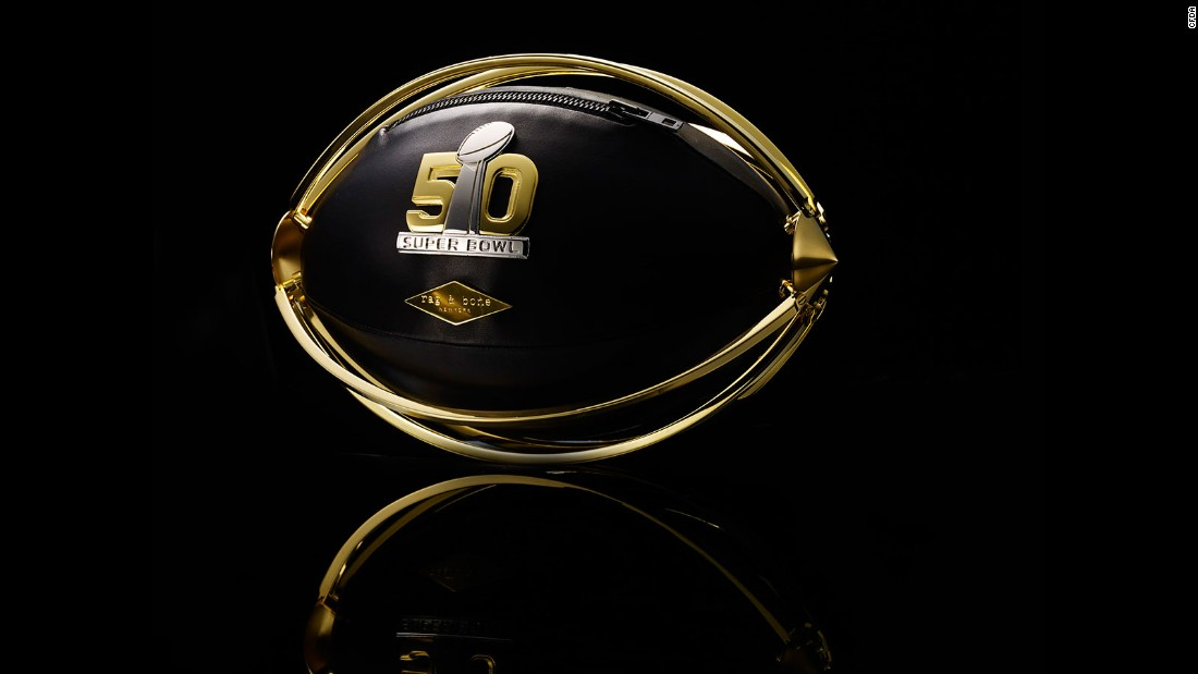 This black leather football is secured inside a gold-plated brass cage.
