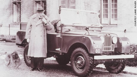 Winston Churchill alongside a Land Rover, one of many high-profile admirers of the off-road vehicle.