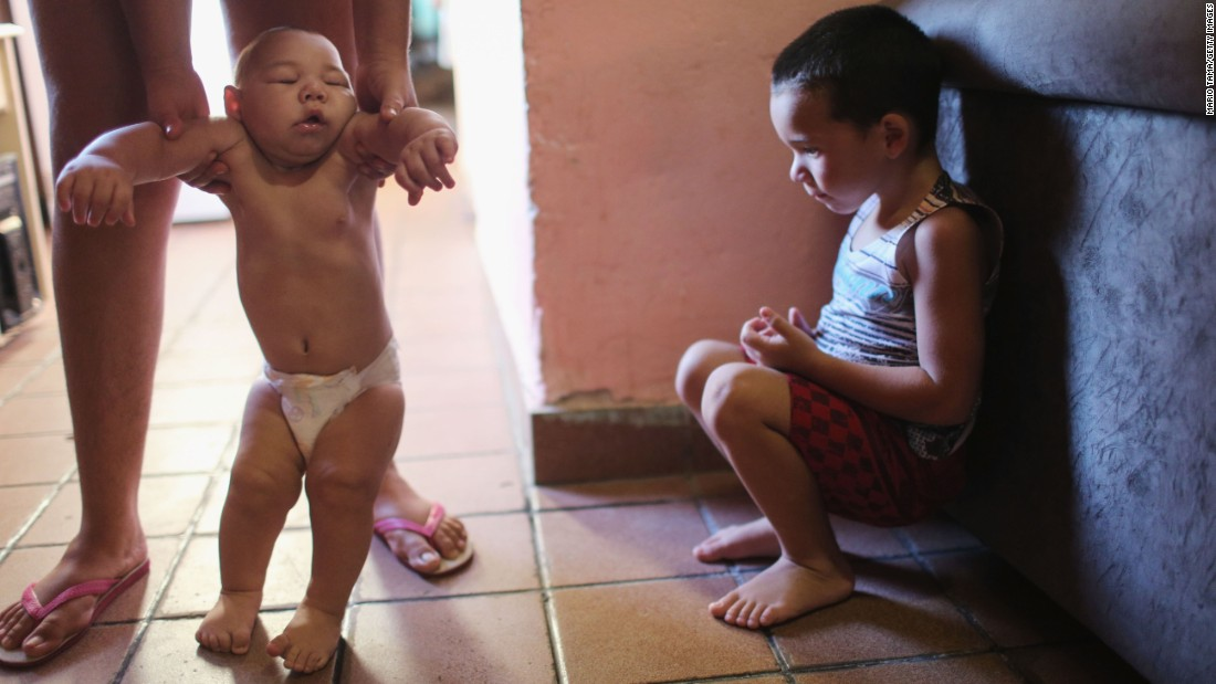 "David Henrique Ferreira, a 5-month-old who has microcephaly, is watched by his older brother in Recife, Brazil, on Monday, January 25. The neurological disorder has been linked to the <a href=""http://www.cnn.com/2016/01/26/health/gallery/zika-virus/index.html"" target=""_blank"">Zika virus</a> and results in newborns with small heads and abnormal brain development. The World Health Organization expects the Zika outbreak <a href=""http://www.cnn.com/2016/01/25/health/who-zika-virus-americas/index.html"" target=""_blank"">to spread to almost every country in the Americas.</a>"