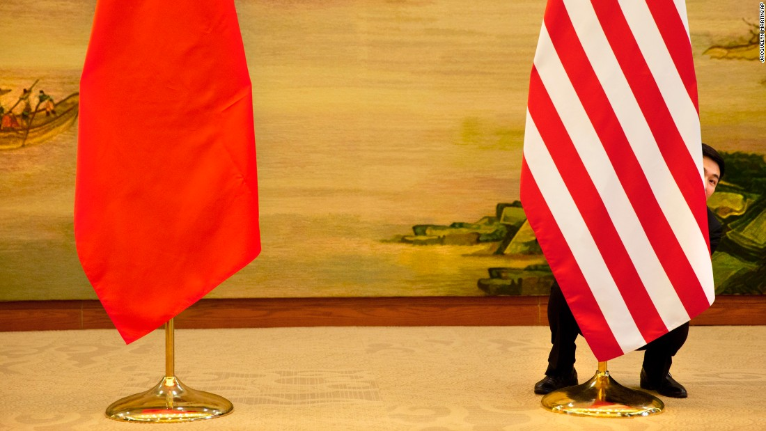 A U.S. flag is tweaked in Beijing ahead of a news conference between U.S. Secretary of State John Kerry and Chinese Foreign Minister Wang Yi on Wednesday, January 27.