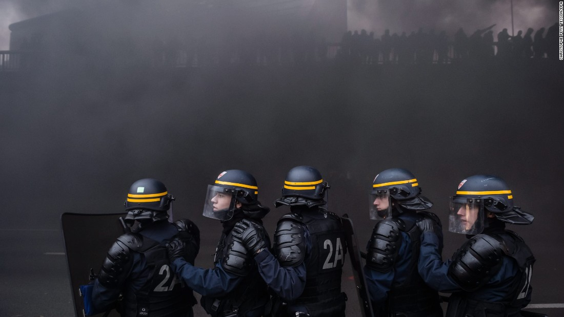 "Riot police in Paris clash with taxi drivers <a href=""http://www.cnn.com/2016/01/26/europe/france-taxi-air-traffic-controllers-strike/index.html"" target=""_blank"">who clogged roadways in protest</a> on Tuesday, January 26. Taxi unions want the French government to enforce laws regulating Uber-like companies."