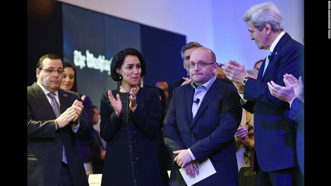 "Journalist Jason Rezaian, second from right, is applauded during the inauguration of The Washington Post headquarters on Thursday, January 28. A day earlier, Rezaian <a href=""http://money.cnn.com/2016/01/27/media/jason-rezaian-visit-washington-post/"" target=""_blank"">visited the newspaper</a> for the first time since he and three others were freed from an Iranian prison earlier this month."