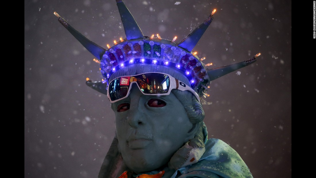 A man poses as the Statue of Liberty during a snowstorm in New York's Times Square on Saturday, January 23.