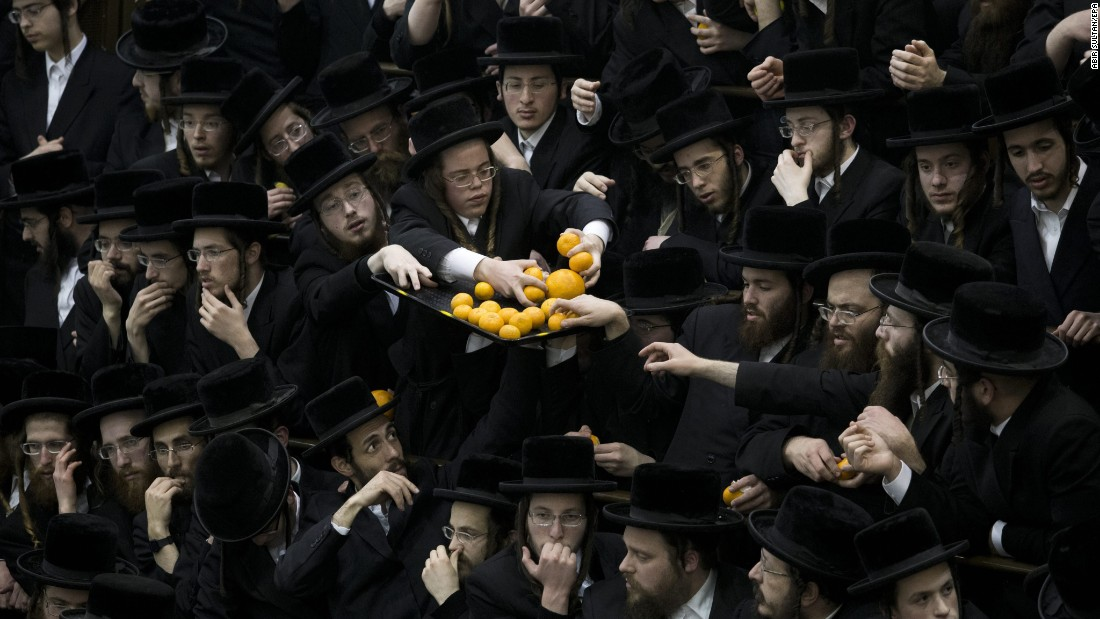 Ultra-Orthodox Jews in Jerusalem grab oranges as they celebrate the Jewish feast of Tu BiShvat on Monday, January 25.