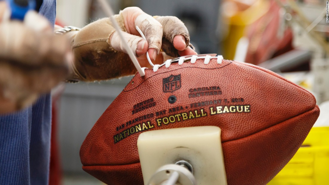 An employee of Wilson Sporting Goods laces a Super Bowl football Tuesday, January 26, in Ada, Ohio. Super Bowl 50 will be played on February 7.