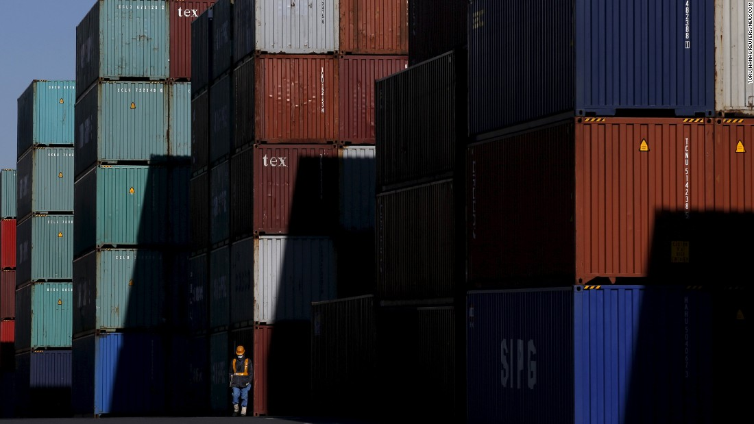 A worker walks through a container area at a port in Tokyo on Monday, January 25.