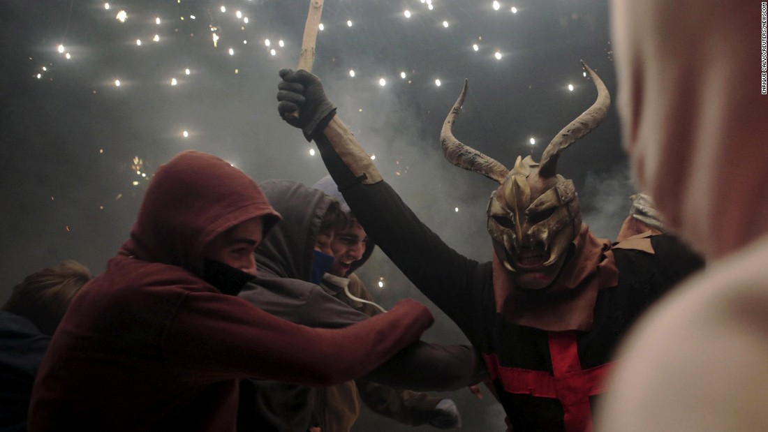 "A reveler dressed as a devil holds a stick with fireworks during traditional celebrations in Palma, Spain, on Sunday, January 24. <a href=""http://www.cnn.com/2016/01/22/world/gallery/week-in-photos-0122/index.html"" target=""_blank"">See last week in 35 photos</a>"