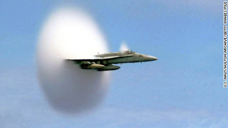 An F/A-18 Hornet breaks the sound barrier.