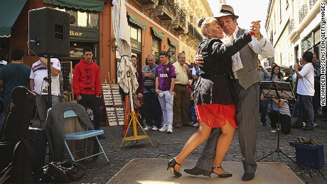 BUENOS AIRES, ARGENTINA - SEPTEMBER 08:  Dancers perform a Tango at Plaza Dorrego in San Telmo on September 8, 2013 in Buenos Aires, Argentina.  (Photo by Alexander Hassenstein/Getty Images)
