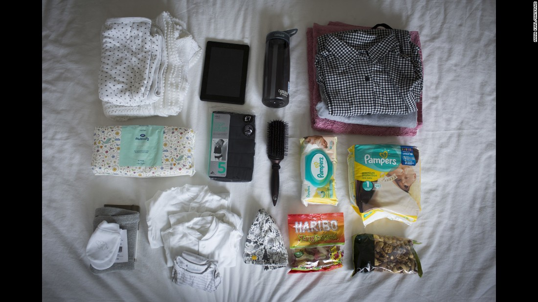 Joanna Laurie's bag includes: diapers, clothes for the baby, clothes for mom, snacks, towel for mom, toiletries, maternity pads, iPad, water bottle, medical notes, a blanket and a maternity TENS machine for pain.