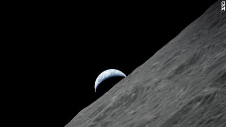 The crescent Earth rises over the moon's horizon in this photograph taken from the Apollo 17 spacecraft in December 1972.