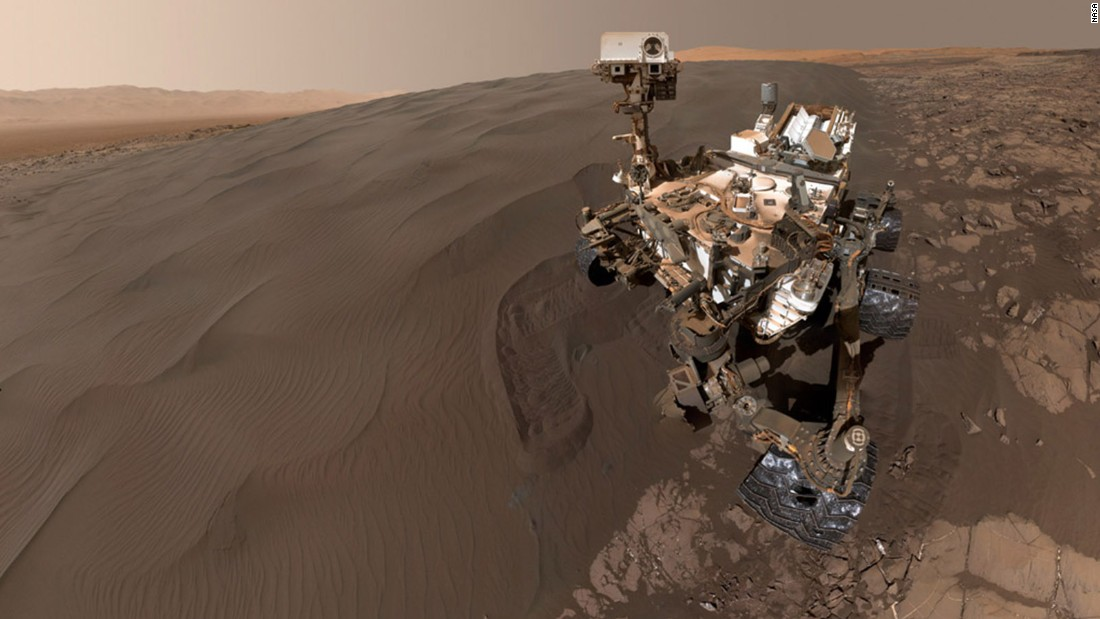 "NASA's Curiosity Mars rover took this January 19, 2016, selfie while sitting at ""Namib Dune."" The rover was scooping up sand from the dune to analyze. The photo combines 57 images taken during the rover's 1,228th Martian day, or Sol. The photos were taken at the end of the rover's robotic arm."