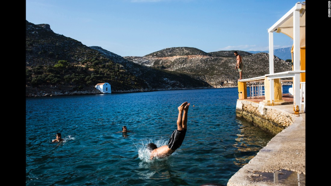 Somar and friends swim on Kastellorizo island, a famous tourist destination, two days after landing on Greece soil.